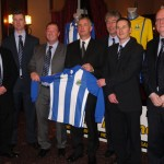 Members of the Newry City AFC Management & Coaching staff, along with Guest of Honour Ollie Raph, unveil the Club's home jersey for the 2013/2014 season.