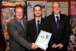 Darren (centre) is pictured here at the Newry & Mourne awards ceremony with Club Chairman Martin McLoughlin (left) and Club secretary Kevin Lyons