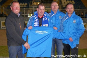 Members of Newry City AFC are pictured here with Paul Mulholland (second from left) from Newmay Electrical Services in London, who kindly sponsored the club's new jackets. The club would like to thank Newmay Electrical Services for their very kind donation.
