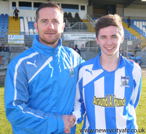 City Manager Darren Mullen congratulates 17 year old Gary Crummy on making his debut for the Newry Senior team