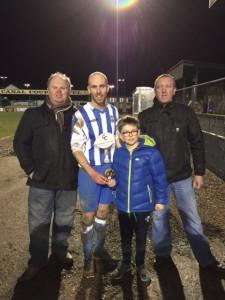 Match Day Sponsors Eden Fuel & Match Mascot Ethan McKevitt present Kevin McArdle with his MOTM Award.
