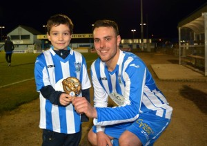 Newry City Match Day Mascot James Curran presenting Graeme Edgar with his MOTM Award.