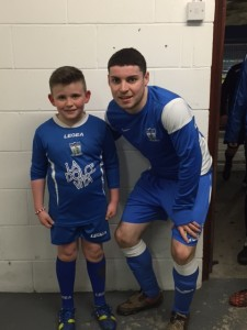 Match day Mascot Anton Britton with Captain Chris McMahon before the game.