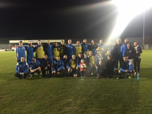 NCAFC Squad&Management with members of the 'Down Right Brilliant' group who all had their odd socks on promoting Down Syndrome Awareness.