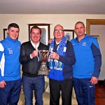 Gerry Mulholland and his son Paul (centre) are pictured here with the Premier Cup some months back, alongside Newry players Chris McMahon and Sean McMullan