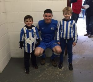 Match day Mascots Noah and Adam with Captain Chris McMahon before the game.
