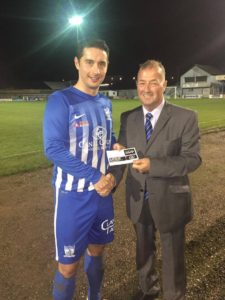 Chairman Martin McLoughlin presents Neil Mullen with his Man of the Match Award sponsored by Hughes BET.