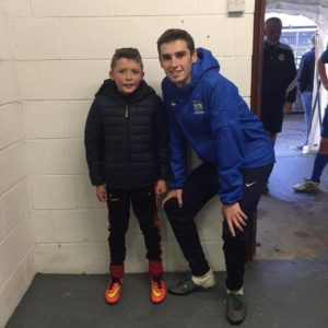 Match Day Mascot Eoin Cunningham with NCAFC Player Mark McCabe.