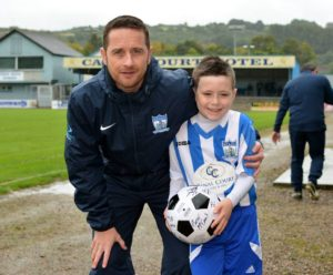 Manager Darren Mullen with Match Day Mascot Louis Watson.
