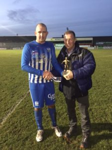 Sean McMullaan receiving his MOTM Award sponsored by Hughes BET from Chairman Martin McLoughlin