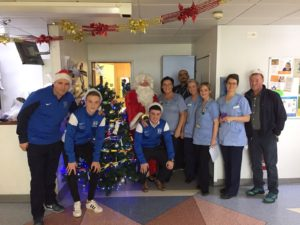 Chairman Martin McLoughlin, Players Sean, Jordan and Chris along with Santa and staff from the ward.
